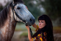 Young women riding a horse Royalty Free Stock Images
