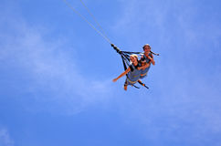 Young women rids on SkyCoaster bungee jump Stock Image
