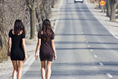 Young women in the road stock images