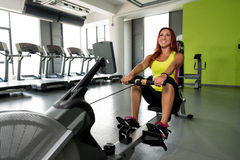 Young women on a rowing machine Royalty Free Stock Photo