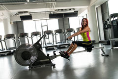 Young women on a rowing machine Royalty Free Stock Photography