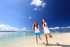 Young women running on beach Royalty Free Stock Images