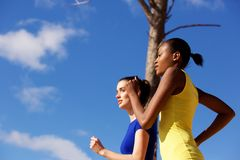 Young women running together outdoors Royalty Free Stock Photo