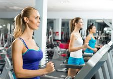 Young women running on a treadmill Stock Image