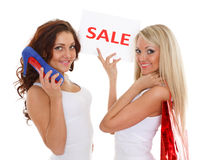 Young  women with sale sign. Royalty Free Stock Images