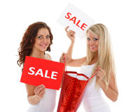 Young  women with sale sign. Royalty Free Stock Photo