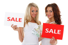 Young  women with sale sign. Royalty Free Stock Photos