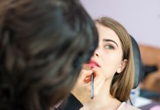 Young woman at salon for a make up royalty free stock photos