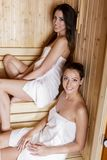 Young women in the sauna Stock Photo