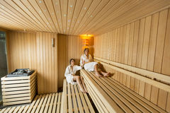 Young women in sauna Stock Photography
