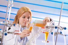 Young women science professional pipetting solution into the gla Royalty Free Stock Images