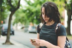 Young women sending message with smartphone. royalty free stock images