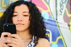 Young women sending message with smartphone. royalty free stock photos