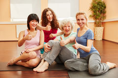 Young women and senior woman holding thumbs up Royalty Free Stock Photo