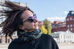 Young women shaking the head with hair blowing in the wind royalty free stock photos