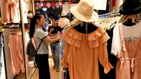 Shenzhen, China: women buy clothing and bras at a clothing store