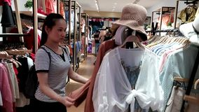Shenzhen, China: women buy clothing and bras at a clothing store. Young women shop in clothing stores for clothes, bras, etc stock video footage