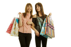 Young women shopping. Two young women with shopping bags Royalty Free Stock Image