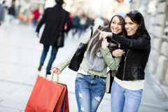 Young women in the shopping Stock Photos