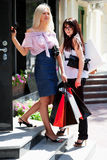 Two young fashion women with shopping bags Royalty Free Stock Images