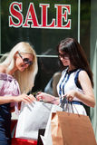 Young women with shopping bags Stock Photos