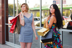 Young women with shopping bags Stock Photo