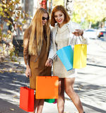 Young women with shopping bags Royalty Free Stock Photography
