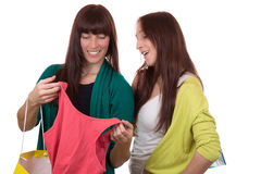 Young women with shopping bags buying clothes Stock Photos