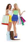Young women with shopping bags. Happy young women with shopping bags on a white background Stock Photo