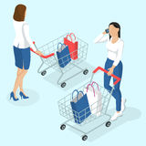 Young women with shopping cart. Stock Photography
