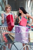 Young women with shopping carts Royalty Free Stock Image