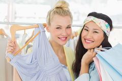 Young women shopping in clothes store Royalty Free Stock Photos