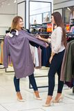 Young women shopping and looking at some clothing in a store Stock Photo