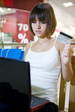 Young women shopping online in mall Royalty Free Stock Images