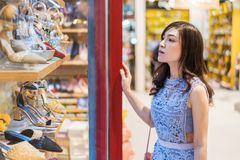 Young women shopping at shoes store Royalty Free Stock Images