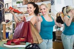 Young women shopping shoes Stock Photos