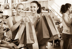 Young women shopping shoes Royalty Free Stock Image