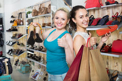 Young women shopping shoes Royalty Free Stock Photo