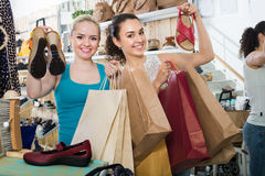 Young women shopping shoes Stock Photography
