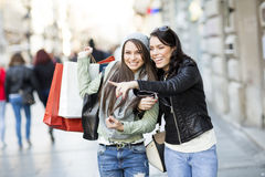 Young women in the shopping Stock Photography