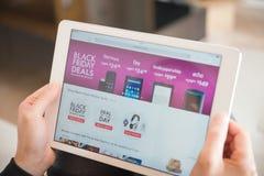 Young women shopping through tablet on Amazon on Black Friday Stock Photos