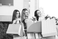 Young women after shopping. Three young women posing on a summer day in the city Royalty Free Stock Photos