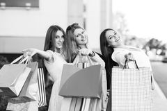 Young women after shopping. Three young women posing on a summer day in the city Royalty Free Stock Photo
