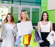 Young women after shopping Stock Images