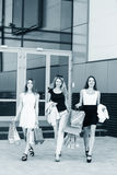 Young women after shopping. Three young women walking on a summer day in the city Stock Photography