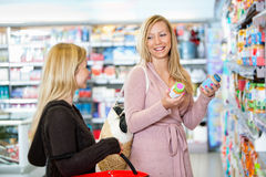 Young women shopping together Royalty Free Stock Photo