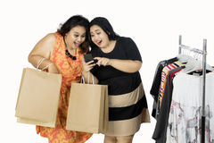 Young women shopping together Royalty Free Stock Image