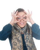 Young women showing binoculars Stock Image