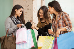 Young women showing her recent purchase Royalty Free Stock Photos