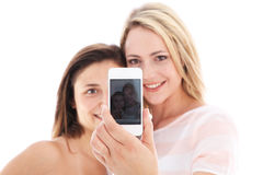 Young women showing their photograph Stock Images